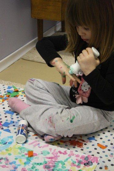 preschooler using ink dabbers