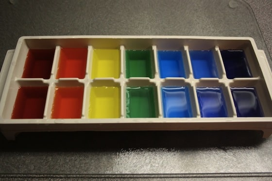 colour a tray of ice cubes for rainbow water