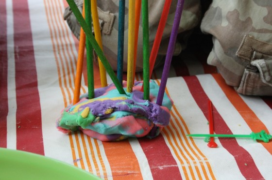craft sticks stuck in ball of play dough