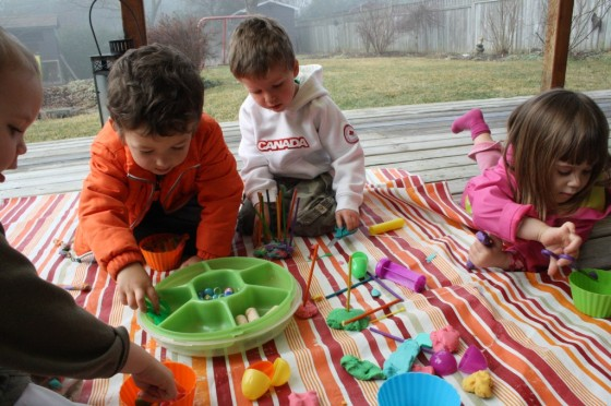 toddlers and preschoolers playing with rainbow play dough