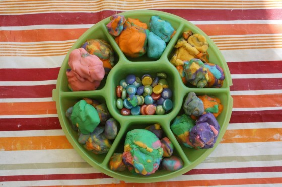 tray of play dough and beads