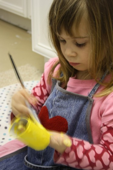child painting toilet roll yellow