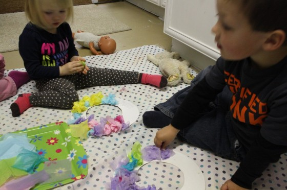 Toddlers working on their Easter wreaths