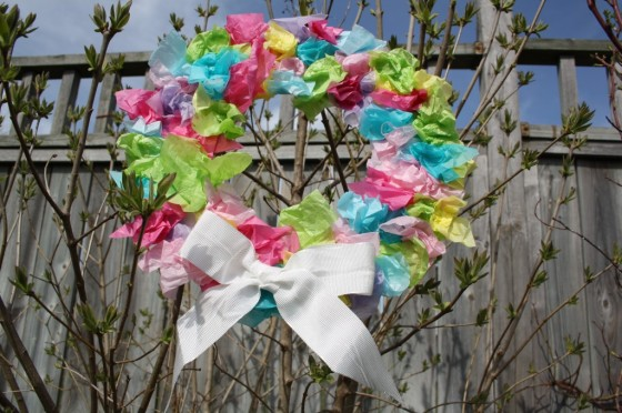 Tissue Paper Easter Wreath hanging in a tree.