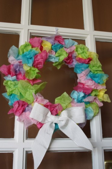 Easter Wreath Made With Tissue Paper Hanging On A Door