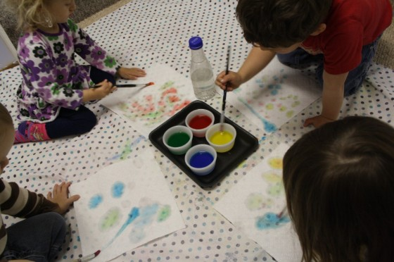 kids colouring paper towel with coloured water