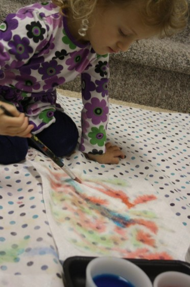 preschooler painting paper towel butterfly wing