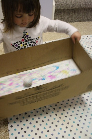 golf balls and paint in a box for making an easter craft garland