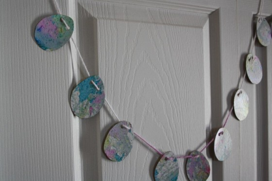 Marbleized Easter Egg Garland hanging from a door.