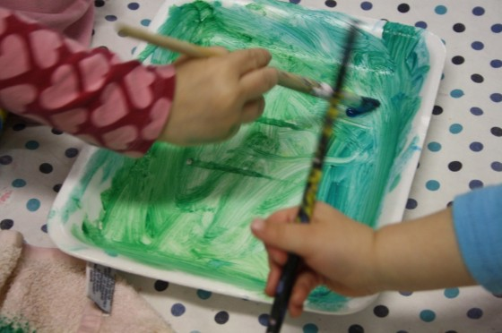 painting styrofoam trays for a spring toddler art project