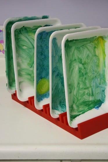 painted styrofoam trays drying in rack