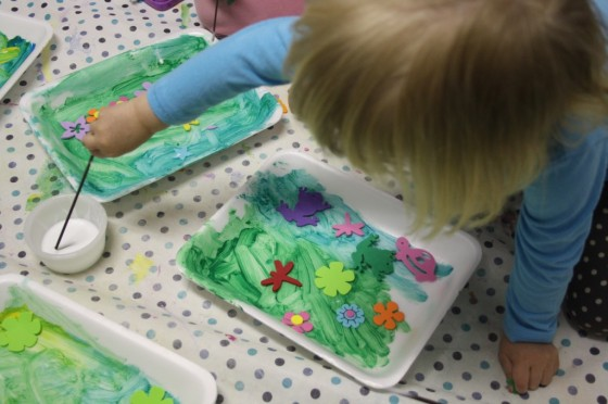 child painting styrofoam produce tray