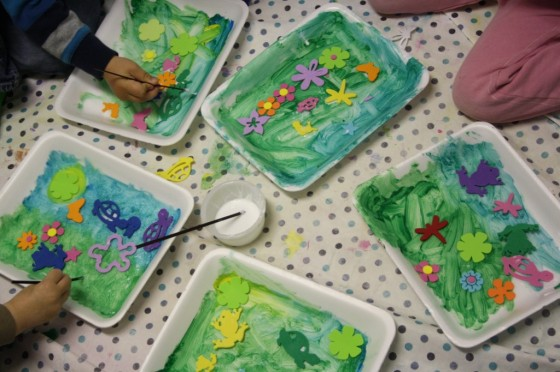 4 children painting styrofoam.