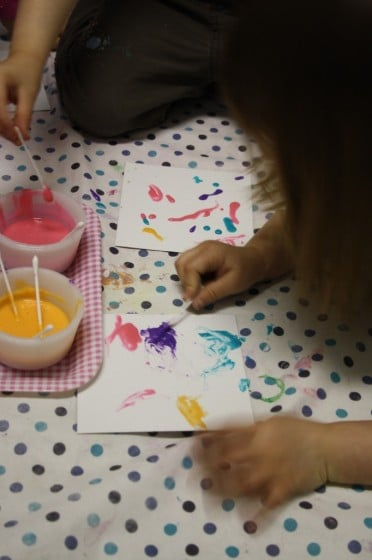 kids painting with homemade puffy paint