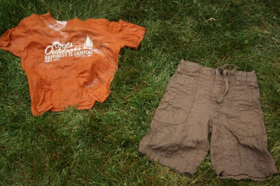 wet clean shirt and shorts laying on grass