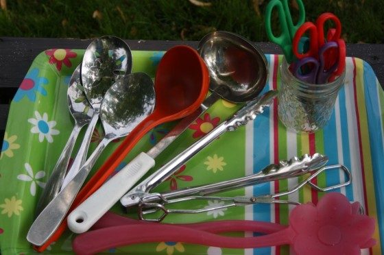 scoops, ladles, tongs on serving tray