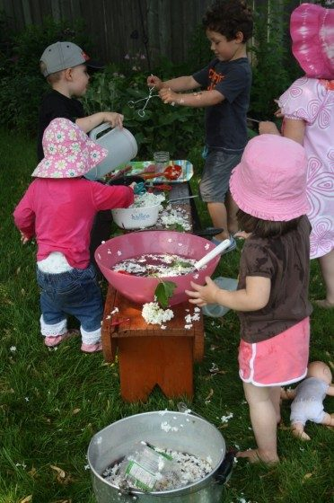 Toddlers and preschoolers making garden soup as a sensory activity