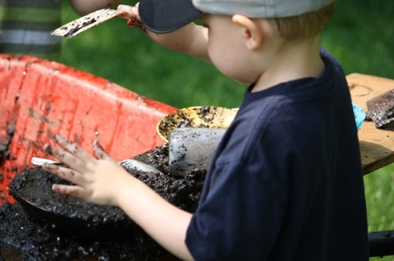 Mud pit for play in a wheelbarrow
