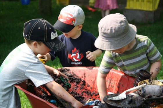 Temporary Mud Pit in a Wheelbarrow – a Creative Backyard Playspace Solution