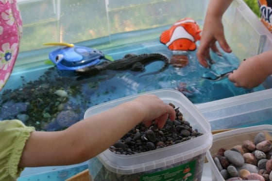 preschoolers playing in ocean sensory bin