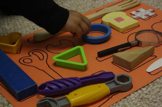 Child playing with homemade matching game.