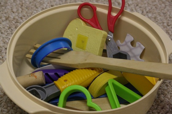 bowl full of toys and utensils for homemade matching game