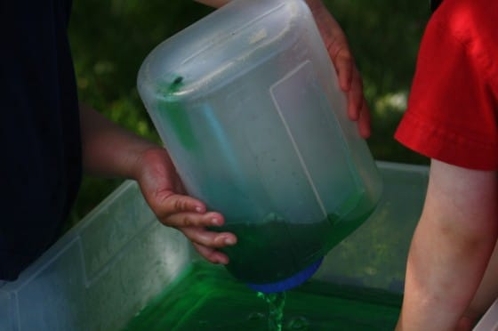 kids pouring coloured water