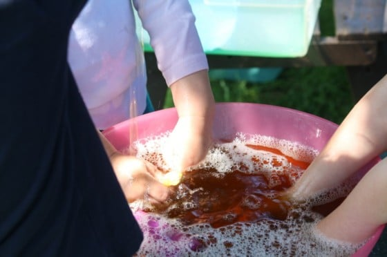 kids playing with bowl of coloured water