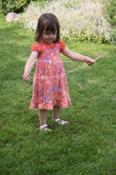 Toddler holding homemade giant bubble wand
