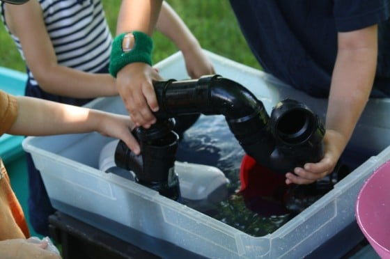 preschool water play and science activity - pvc pipes, funnels and water
