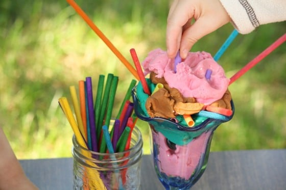 preschooler pressing play dough into ice cream dish