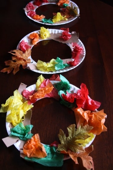 3 fall wreaths made by toddlers and preschoolers with tissue paper and paper plates