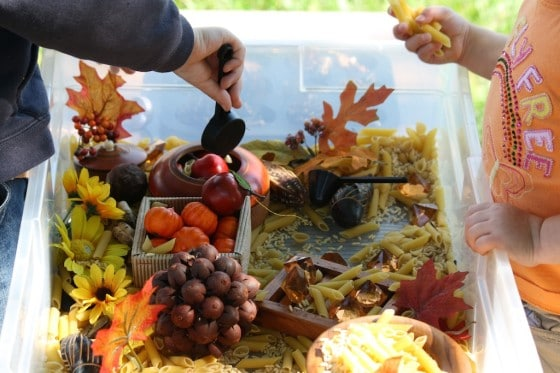 preschool boys shopping pasta in fall sensory bin