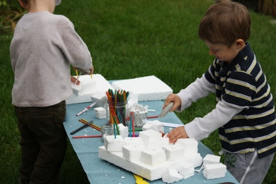 preschool boys constructing with styrofoam - pretend play