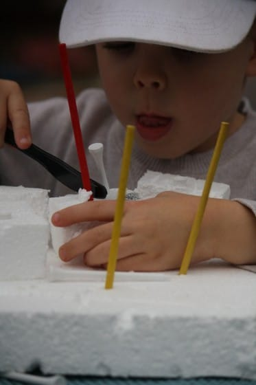 toddler building with homemade styrofoam construction set