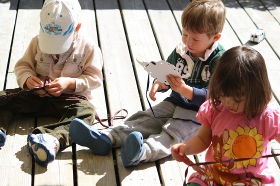 toddlers using homemade lacing cards