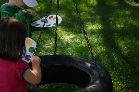 imaginary play in the yard with pretend paint pallet