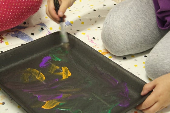 Kids painting styrofoam meat trays