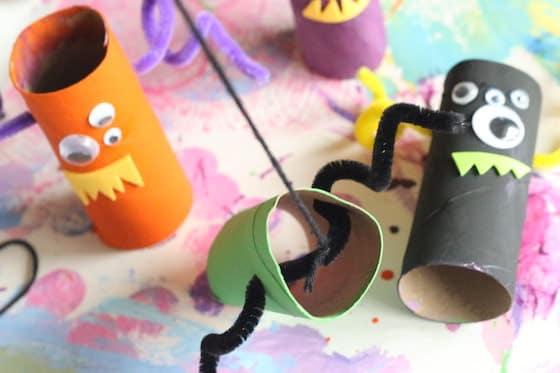 Tying yarn to toilet roll monster