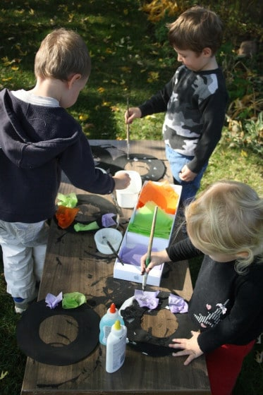 kids decorating halloween wreaths with tissue paper