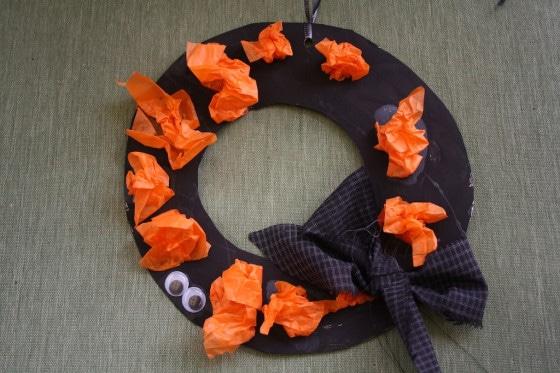 black halloween wreath with orange tissue paper