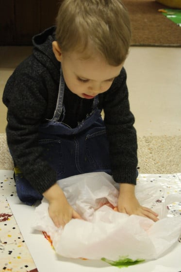 child smoosh painting with plastic bag
