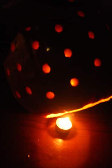 drilling holes in a pumpkin