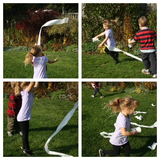 kids running in the yard, unravelling roll of toilet paper