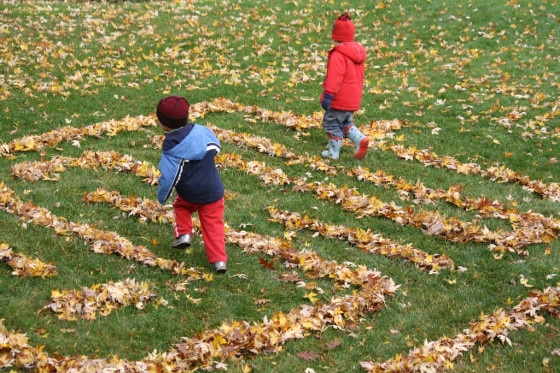 kids running through leaf maze