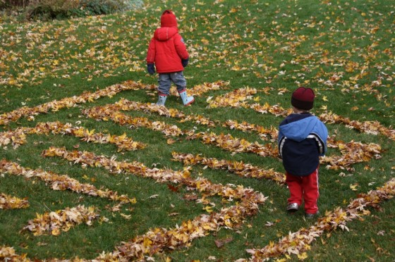 backyard leaf maze, toddler in red jacket, preschooler in blue jacket