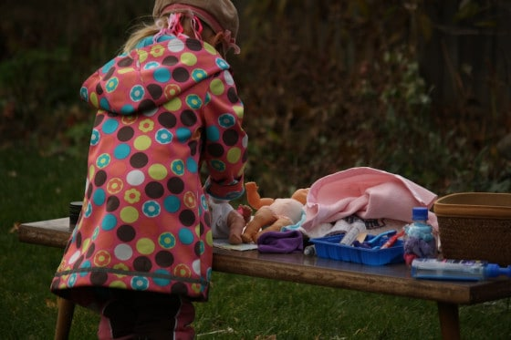 preschooler putting diaper on doll