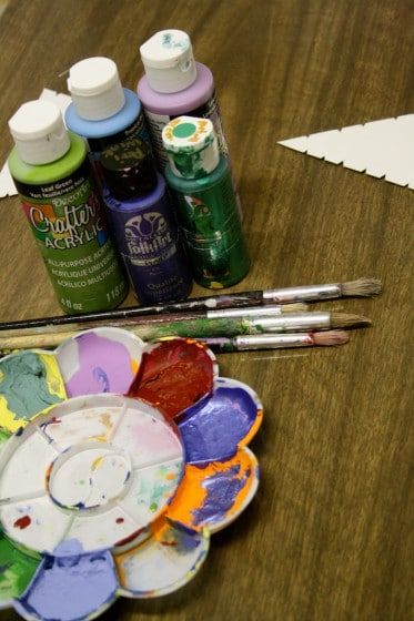 a variety of acrylic paints for wool wrapped tree ornaments
