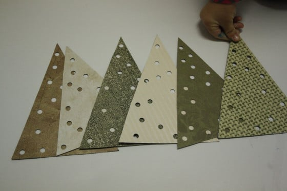holes punched in triangles for lacing tree ornaments