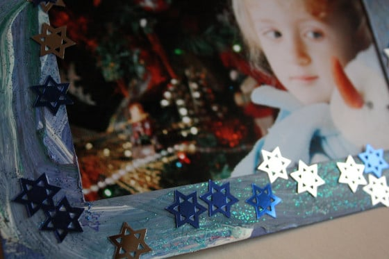 Kid's homemade picture frame with Christmas photo